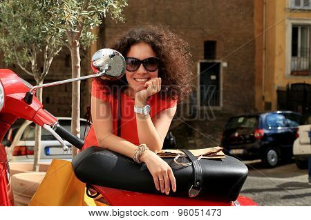Girl near the scooter