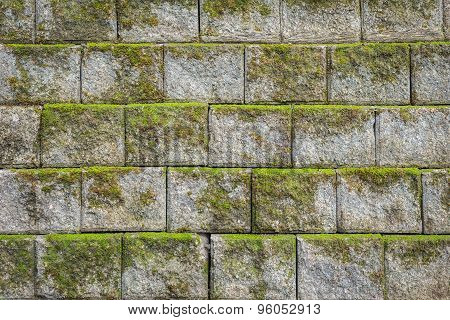Stone Wall Pattern With Green Moss Background And Texture