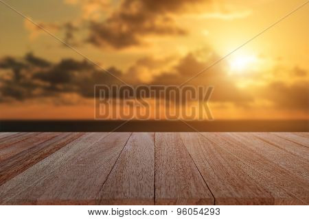 Top Wooden Table And Blur Sunset Background
