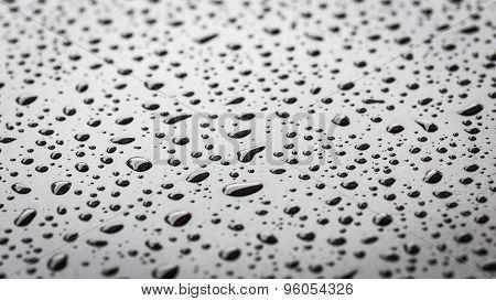 Macro Water Drop On Black Stone Texture