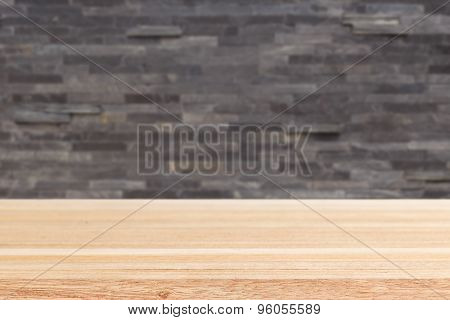 Empty Top Of Wooden Table Or Counter And Black Slat Wall