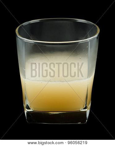 Bourbon Benedictine cocktail in a rocks glass isolated on black background