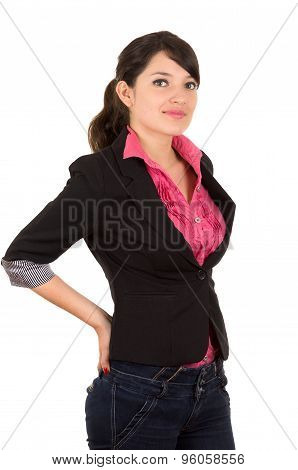 Hispanic woman in pink shirt and black blazer jacket upper body shot arms placed behind lower back l