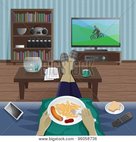 Man take supper at home and watching TV
