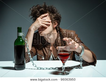 Young Man Drinking Red Wine And Feeling Despair