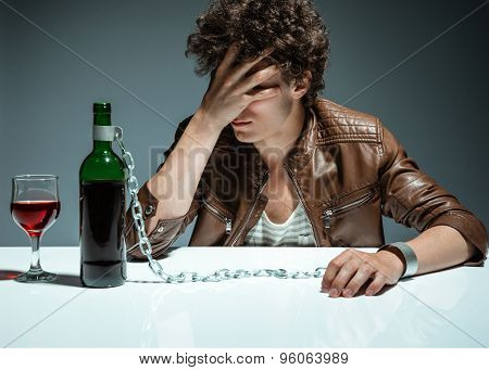 Sad And Depressed Young Man In Alcohol Addiction