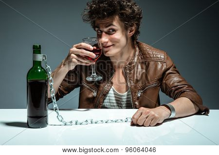 Man Proposing A Toast With A Glass Of Red Wine And Looking At The Camera