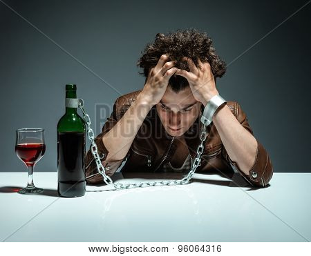 Intoxicated Man Sitting Alone / Photo Of Youth Addicted To Alcohol, Alcoholism Concept