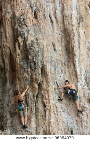 PHRA NANG BEACH, THAILAND,  FEBRUARY 11, 2015 : Two female climbers are training on the cliff of the Phra Nang beach in the Krabi province in Thailand