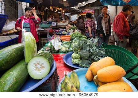 CHIANG MAI, THAILAND, DECEMBER 30, 2015 : Vegetables and fruits sellers in the Talat Pratu market at the south gate in Chiang Mai, Thailand