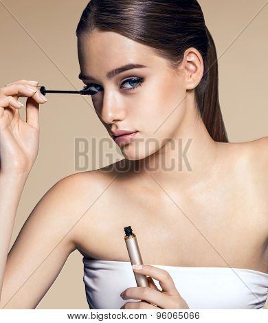 Charming Woman Applying Mascara