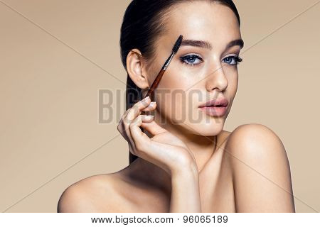 Beautiful Woman Using Mascara