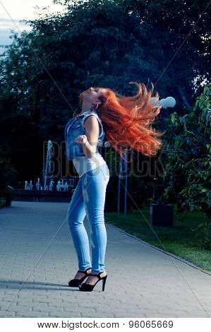 Full length portrait of red haired women shaking her head. Long