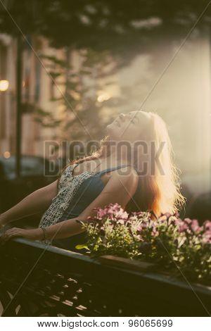Happy women enjoy summertime in city park backlit shot