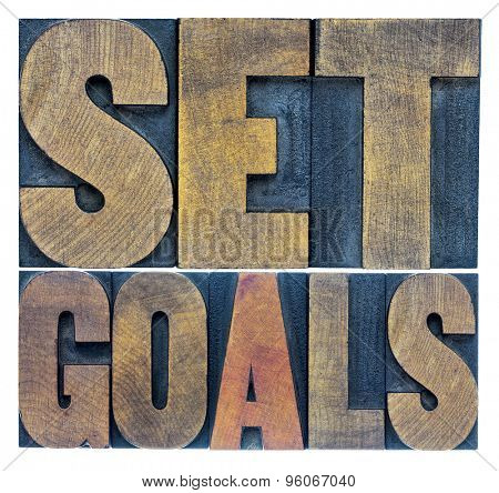 set goals typography abstract - a collage of isolated words in letterpress wood type