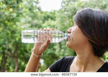 Asian Young Girl Drink Water From Bottle