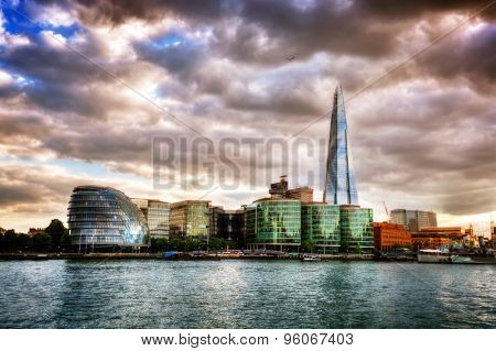City Hall, the Shard and the More London buildings. London, England the UK. River Thames view at sunset