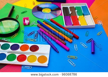 Stationery objects. School and office supplies on the background of colored paper.