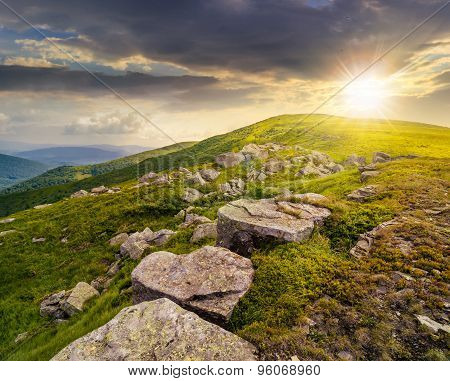 White Boulders On The Hillside At Sunset