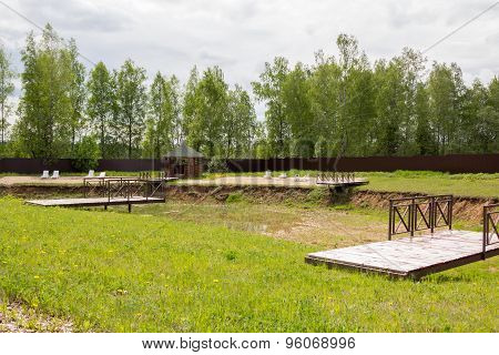 Dry Pond With Deck Chairs And A Gazebo On Shore