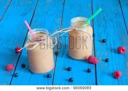 Healthy baby food: apple banana or apricot puree in mason jar, fresh raspberry. Light rural wooden b