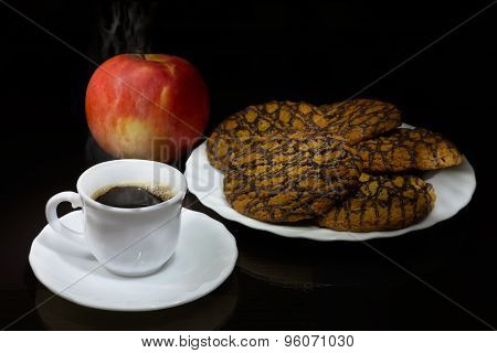 White Cup Of Hot Coffee, Cookies And Red Apple And On Table With Glass Surface. The Morning Breakfas
