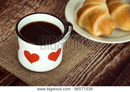 Cup Of Coffee In An Old Enamel Mug On Rustic Background