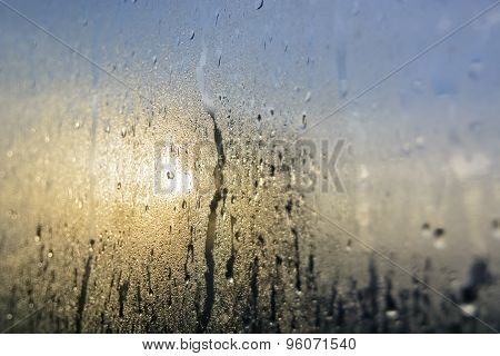 Raindrops On Glass Pane