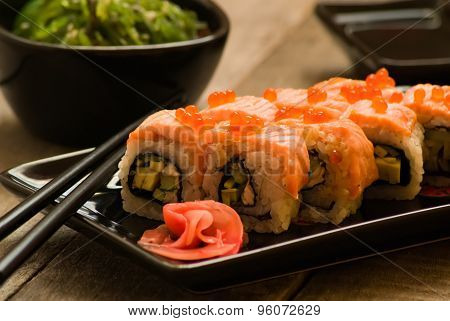 Sushi And Chuka Seaweed Salad With Soy Sauce On Wooden Table