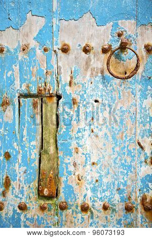 Rusty   Paint In The Blue Wood Door And Morocco Knocker