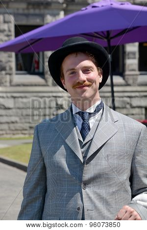 Man reenacting early XX century people