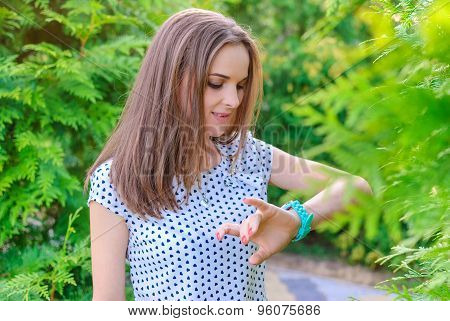 the girl looks at his watch