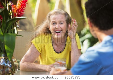 Amazed Lady At Table With Friend