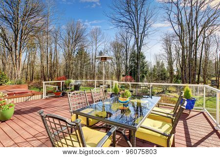 Large Back Yard With Greenery, And Furnished Back Porch.