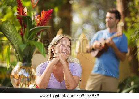 Beautiful Woman And Ukelele Performer