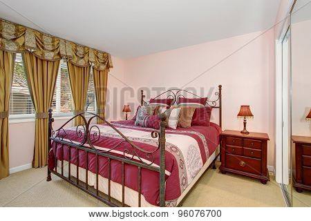 Cozy Bedroom With Red Bedding And Carpet.