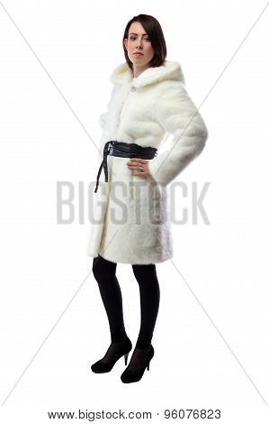 Image of woman in white fur coat, half turned