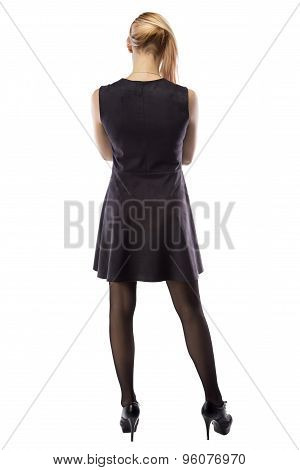 Photo woman in artificial suede dress, from back