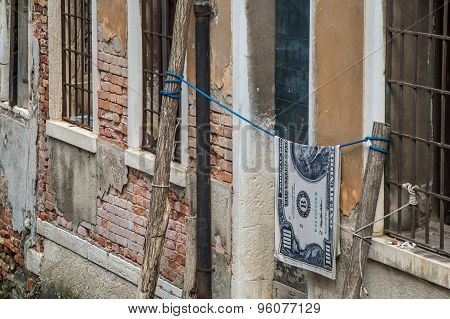 Hundred Dollar Bills Hanging On A Rope