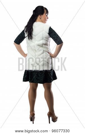 Photo pudgy woman in white fur jacket, from back