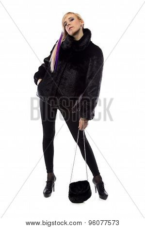 Photo of woman with fur bag, chin up