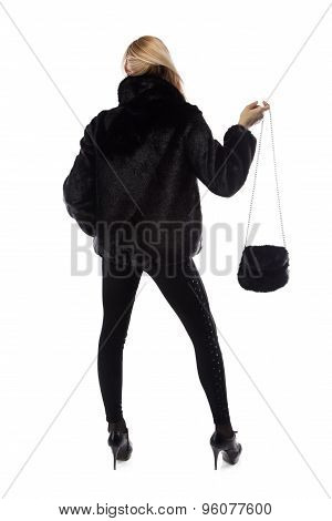 Woman with fur bag, hand up from back
