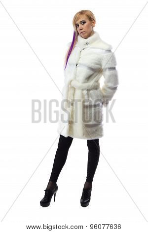 Photo of blonde in white fur coat