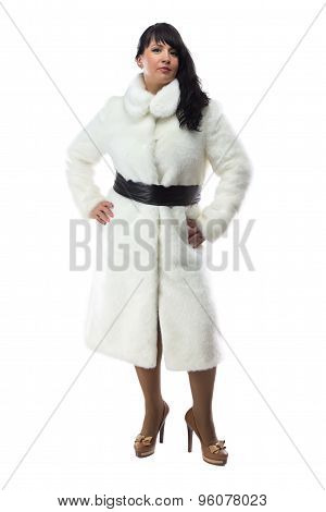 Photo of pudgy brunette in long white coat