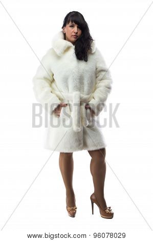Photo of pudgy brunette in short white coat