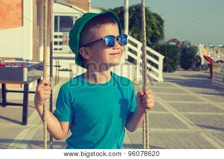Little Boy Swinging Outdoor On Summer Day Vintage Style