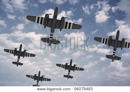 A formation of five American planes, painted with D-Day invasion stripes.