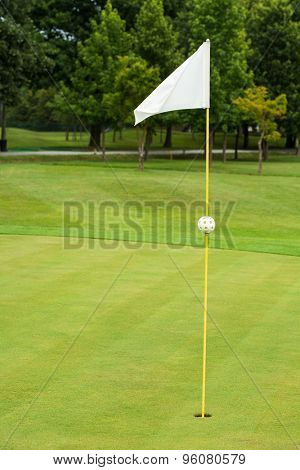 White flag on a golf course, focus on the flag