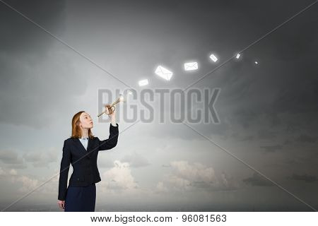 Young businesswoman in suit proclaiming something in horn