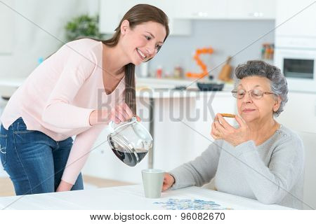 Pouring a coffee for her grandma